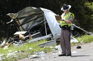 A Florida Highway Patrol trooper investigates a fatal crash on I-75 near mile marker 372.