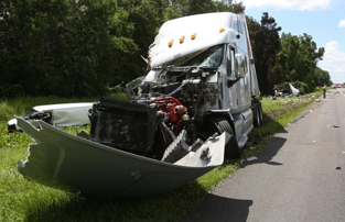 A man was killed and six were injured after a tractor trailer hit an RV that had pulled onto the shoulder of the interstate.