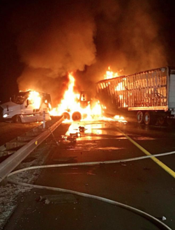 Two semis collided and caught fire Friday morning.