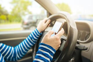 Could the spike in driving deaths be correlated to in-car mobile device usage?
